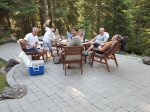 Outdoor dining with family and friends at Tumalo Creek Vacation Rental with river access