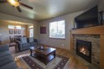 SW Teton, Sleeps 8, Pet Friendly, Open and social living room with queen sofa sleeper and love seat, fireplace, 55 LCD