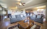 Open and social living room with queen sofa sleeper and love seat, fireplace, 55 LCD, air conditioning