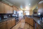 Fully equipped gorgeous kitchen with stainless steel appliances, granite slab counter tops