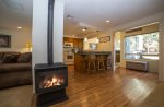 Fully equipped kitchen with electric four burner stove, all stainless steel pots and pans
