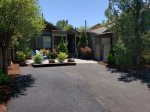 Outdoor dining with patio table and chairs for four under canopy, barbeque with propane provided