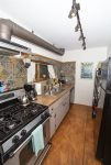 Gas range, oven, fully equipped galley kitchen