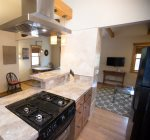 Fully equipped kitchen with gas range and stove