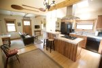 Fully equipped kitchen with gas range oven and breakfast bar for two