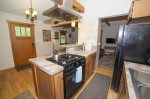 Fully equipped kitchen with gas range and oven