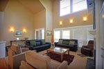 Ample seating for everyone in the living room with a gas fireplace, sleeps 8