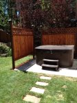 Private hot tub in fenced backyard