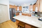 Fully equipped kitchen with stainless steel appliances, gas range and oven