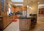 Gorgeous, fully equipped gourmet kitchen with granite counter tops, breakfast bar for two