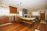 Spacious kitchen with granite slab counter tops, stainless steel appliances and a gas cook top