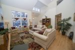 Living room has comfortable sofas, chairs, plenty of board games, large screen television and an electric fireplace.
