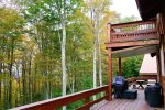 MAIN LEVEL BALCONY WITH GRILL, SITTING AREA, AND PICTURESQUE VIEWS HOT TUB LOCATED ON LOWER LEVEL PATIO