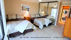 This spacious bedroom fits 2 queen beds