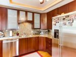 Fully equipped kitchen includes stainless steel dishwasher and refrigerator