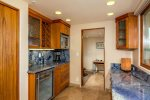 Wet bar complete with wine fridge, wine rack and build in espresso machine