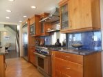 Custom designed kitchen with large stainless steel stove and dishwasher
