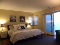 Large bedroom with en suite bath with a small balcony right on the ocean front