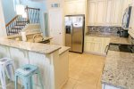Fully Equipped Kitchen With Island Breakfast Bar