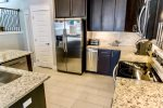 Fully Equipped Kitchen with Granite Counter Tops and Stainless Steel Appliances