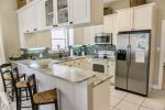 Full Equipped Kitchen with Beautiful Granite Counter Tops and Tile Back Splash