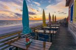 Have dinner and watch the sunset from the beachside deck of Pompano Joe`s