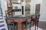 Fully Equipped Kitchen with Additional Seating Available at the Breakfast Bar