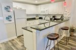 Additional View of Fully Equipped Kitchen has Additional Seating Available at the Breakfast Bar