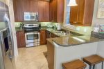 Fully Stocked Kitchen with Stainless Steel Appliances and Granite Counter Tops