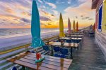 Sit out on the beachside deck and have dinner and cocktails while the sun sets