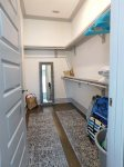 First Floor Master Suite Walk In Closet where you will find various beach items