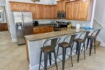 Fully Equipped Kitchen with Granite Counter Tops and Breakfast Bar