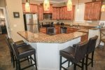Fully Equipped Kitchen With Breakfast Bar And Additional Seating
