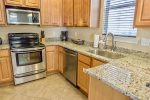 Fully Stocked Kitchen with Stainless Steel Appliances & Breakfast Bar