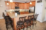 Fully Equipped Kitchen With Stainless Steel Appliances and Island Breakfast Bar