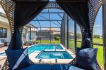 Relax under the gazebo daybed with amazing views of Champions Gate