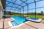 Relax in your own private screened pool with spillover spa