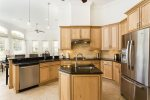 Fully equipped kitchen featuring stainless steel appliances and granite counters