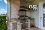Your very own summer kitchen, complete with an outdoor TV