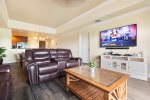 Spacious living room with 65-inch SMART TV and PlayStation 4