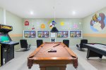 The games room has a pool and air hockey table for lots of fun and entertainment