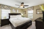 Upstairs king bedroom with neutral tones and personal TV