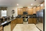 Updated spacious kitchen with granite counters and stainless steel appliances