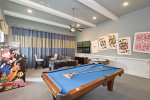 Challenge your family members to a game in this awesome games room