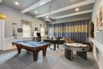 Fully equipped for fun with a pool table, air hockey, foosball table, arcade games and video game platforms