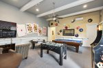 Custom paintings on the walls add to the fun atmosphere of the games room