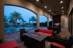 Relax under the covered patio and enjoy the beautiful view