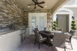 The family will love the summer kitchen during your vacation