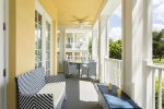 The corner of the wraparound porch has seating for 2 to relax in privacy