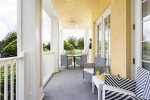 Relax anytime out on the balcony with matching patio furniture